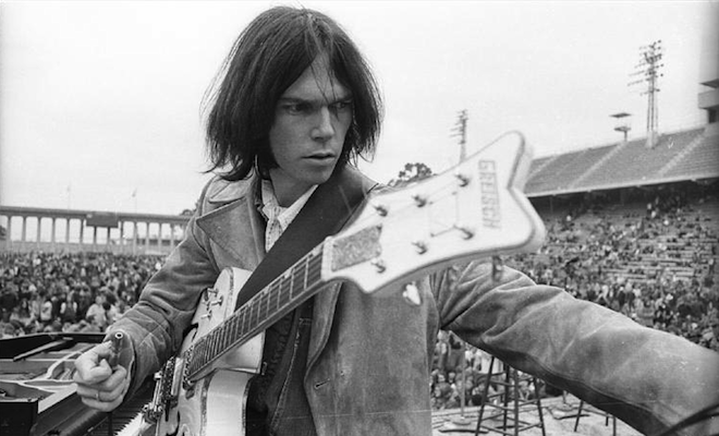neil-young-busts-record-shop-for-selling-csn-breaks-candle-in-protest