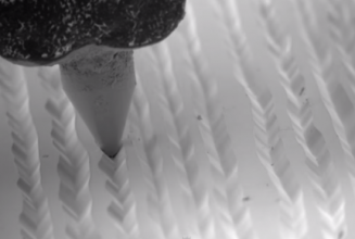 Watch a stunning microscopic slow-motion video of a needle on a record