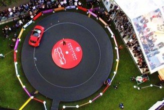 Watch a giant vinyl record get played by a car