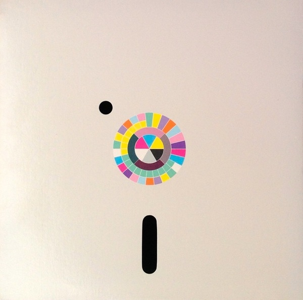 The back cover featuring the Peter Saville-designed colour wheel decoder