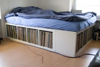 The queen size bed with vinyl record storage