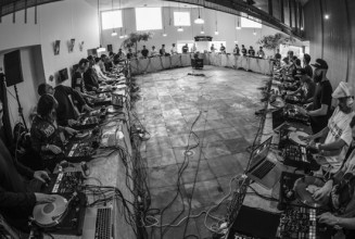 Watch 40 DJs break the record for the world's biggest scratch session