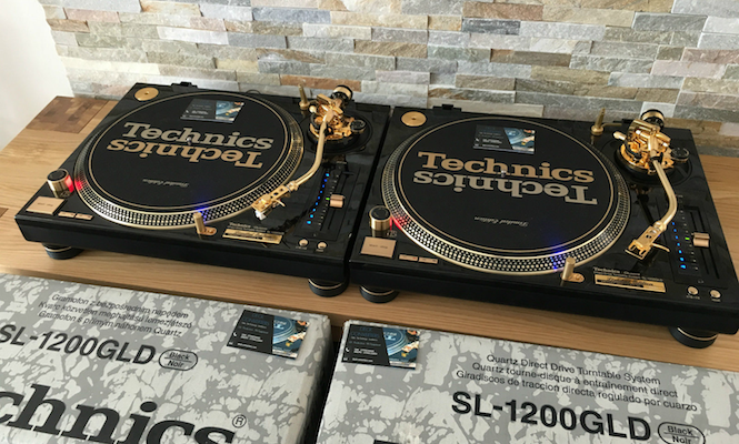 a rare set of gold technics sl 1200 turntables are up for sale