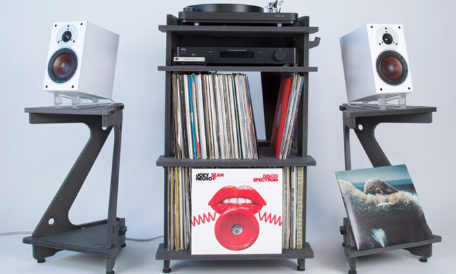 These flexible speaker stands feature an angled platform base and record storage